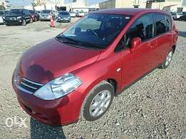Wine red Tiida hatchback on sale: Hire purchase