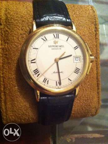 Raymond weil geneve gold case and Authentic machine