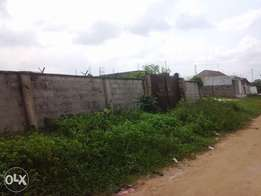 2 plots of land with fence and gate and water.