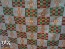 Aniwa Bonwire Red, Yellow, Green and Cream Bonwire Kente Cloth.