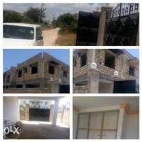 Quick sale: Unfinished flat with 4th floor near 7Star,Bamburi