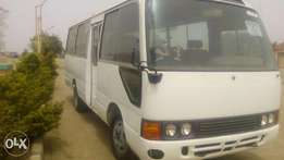 Toyota coaster bus wit new engine & new tyres.
