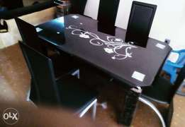 Imported new glass dining table with chairs