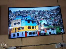 55inches UHD curve Samsung TV. Newly imported, neat and perfect cond.