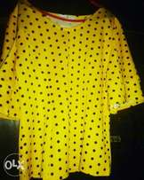 Yellow Top with black polka dots by Famous Fashion