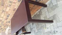 Awesome desk with a drawer and stitching along seams . Good condition