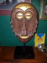 Wooden mask on stand