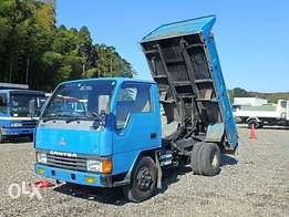 Mitsubishi Canter Dump truck in bonded ware house kampala for sale
