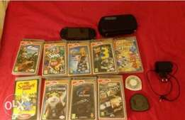 psp for sale with 11 games and a case and charger
