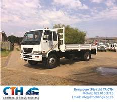 2010 Nissan UD80 with Dropside Body