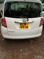 Old shape Pearl white Toyota Ractis