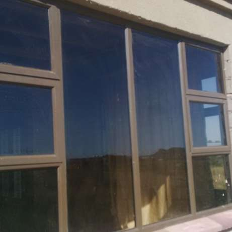 Aluminium doors and windows. Retractable security doors and barriers Secunda - image 4