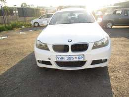 Finance available for 2010 BMW 320i ,white in color ,4 doors ,90 000km