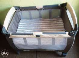 A fairly used Graco Baby bed