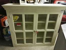 Cream glass display cabinet