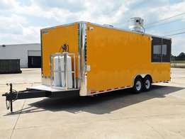Enclosed concession trailer on wheels.