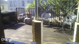 1-Bed house for long term rent, furnished with a deck. Water incl.