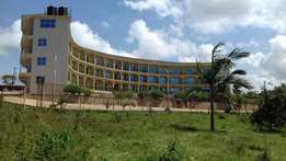 Hotel on sale in entebbe..fully furnished at 5m $$..on 0.815 hectares