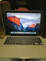 MacBook pro i5. 13 inch screen comes with guarantee in excellent condi
