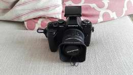 Olympus OMD EM5 with lens and Olympus Fl50 Flash and 4 other lenses