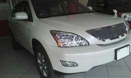 Toyota Harrier pearl white color with sunroof, leather interior