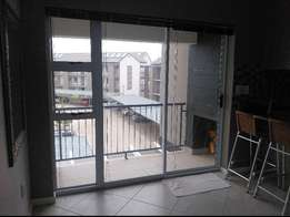 Beautiful new 2 bedroom apartment with marble tops and braai!
