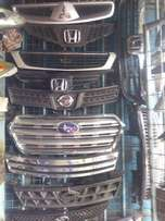 This are GENUINE front bumpers , grills and side mirrors for various c
