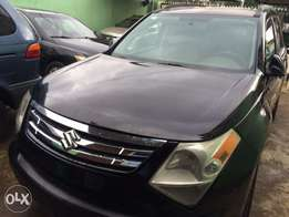 Super clean Nigeria used Suzuki XL7 2009 model 3 seater row.