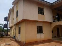 Block of four flat for sale in benin city with land size of 150/100