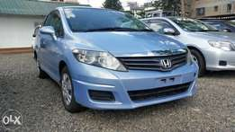 Extremely clean light blue,Honda air wave, v-tech engine,2009 model.