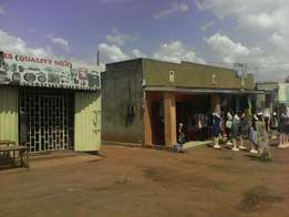 Business Buildings and a plot for sale ( Nansana )