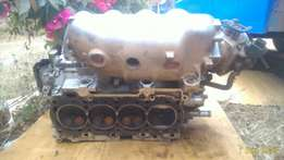 Clean Complete cylinder head with throttle for 2zz engine.