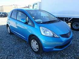 Blue Honda Fit fully loaded