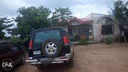House and shops on a 7200sqr.m Land at Ikorodu
