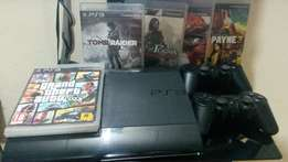 Ps3 console with 7 cds and 3pads