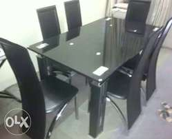 This is a brand new imported Glass dining table