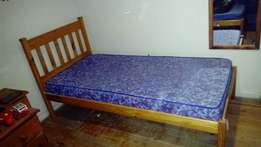 2 identical pine single beds with mattresses