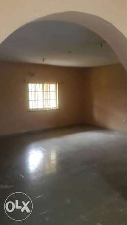 Standard and spacious 300k with 3t at igando facing a tarred rd Ikotun - image 7