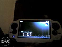 ps vita hacked with henkaku with 5 games in sd