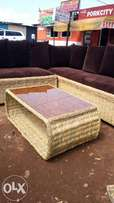 Brand new makuti coffee table with brown tinted glass on sale