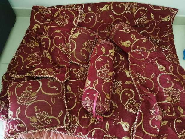 A brand new king size QUILT with cushions and covers