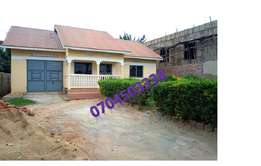 3bedroomed and 1 boys quater with bangalow in kisasi kyanja at 140m