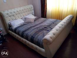 White leather 5 by 6 comfortable strong bed
