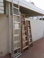Three ladders, 4.2m extended Aluminium, 2.1m and 1.8 wooden ladders