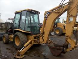 Company used Caterpillar 420D model with back hoe for sale