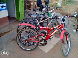 4 mountain bikes 3 with shock absorbers
