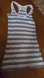 130990c08795ee Śliczna bluzeczka bokserka S srebrne nitki bdb