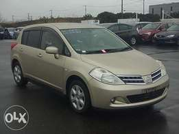 Nissan Tiida. Hatchback. Gold colour: Deposit accepted