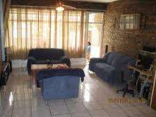 Room avaialable for a lady in a 3 bedroom townhouse