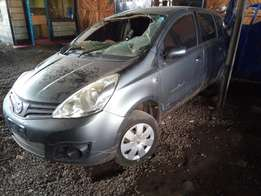 A clean insurance salvage Nissan Note.
